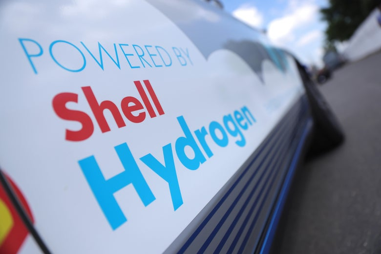 """The side of a truck reads """"Powered by Shell Hydrogen,"""" with the Shell logo."""