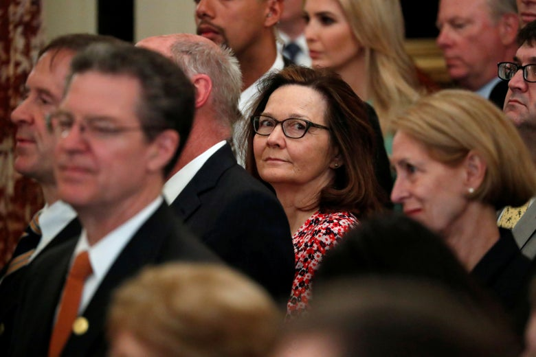 Central Intelligence Agency (CIA) director nominee Gina Haspel (C) attends Secretary of State Mike Pompeo's ceremonial swearing-in at the State Department in Washington on May 2, 2018.