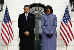 US President Barack Obama and First Lady Michelle Obama observe a 'moment of silence'. Click image to expand.