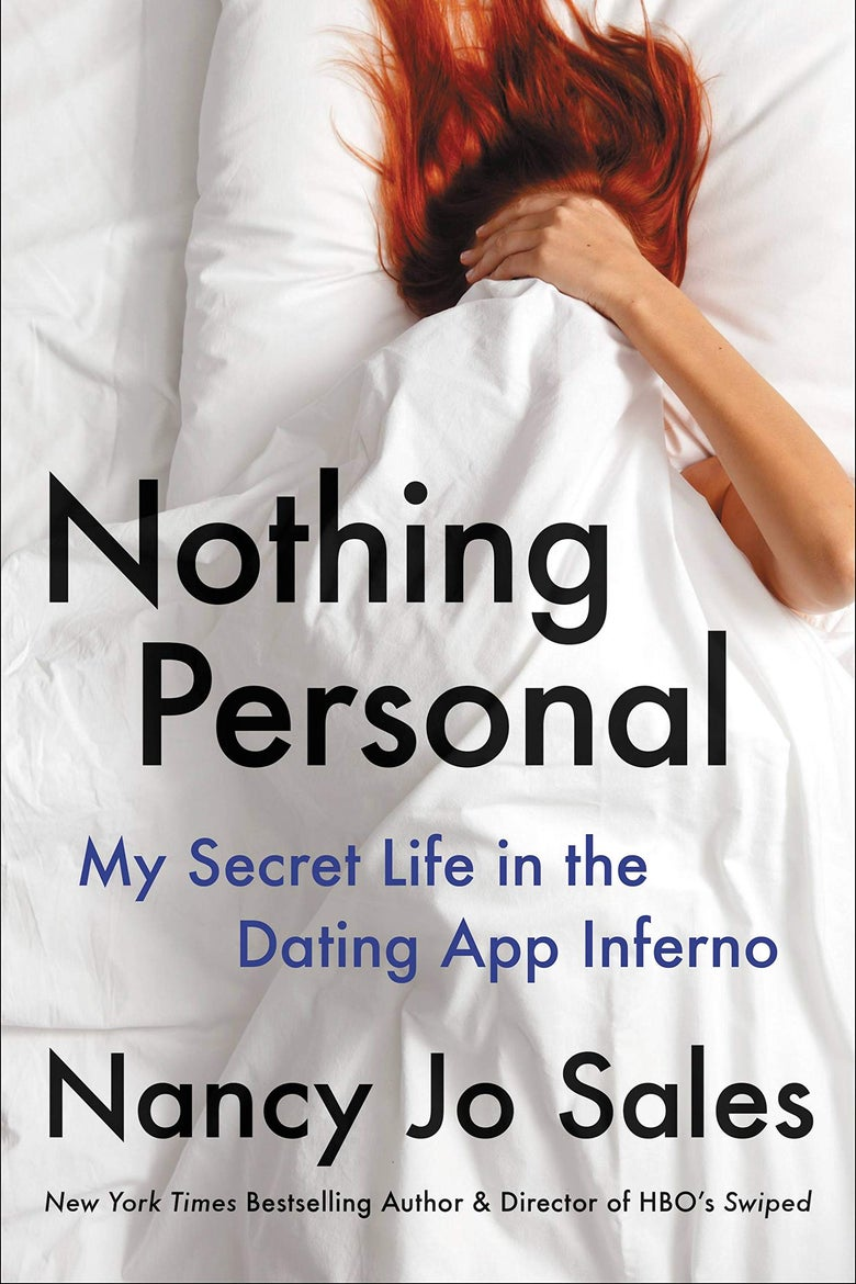 A book cover with a red-haired woman lying between white sheets. She is covering her face with the sheets.