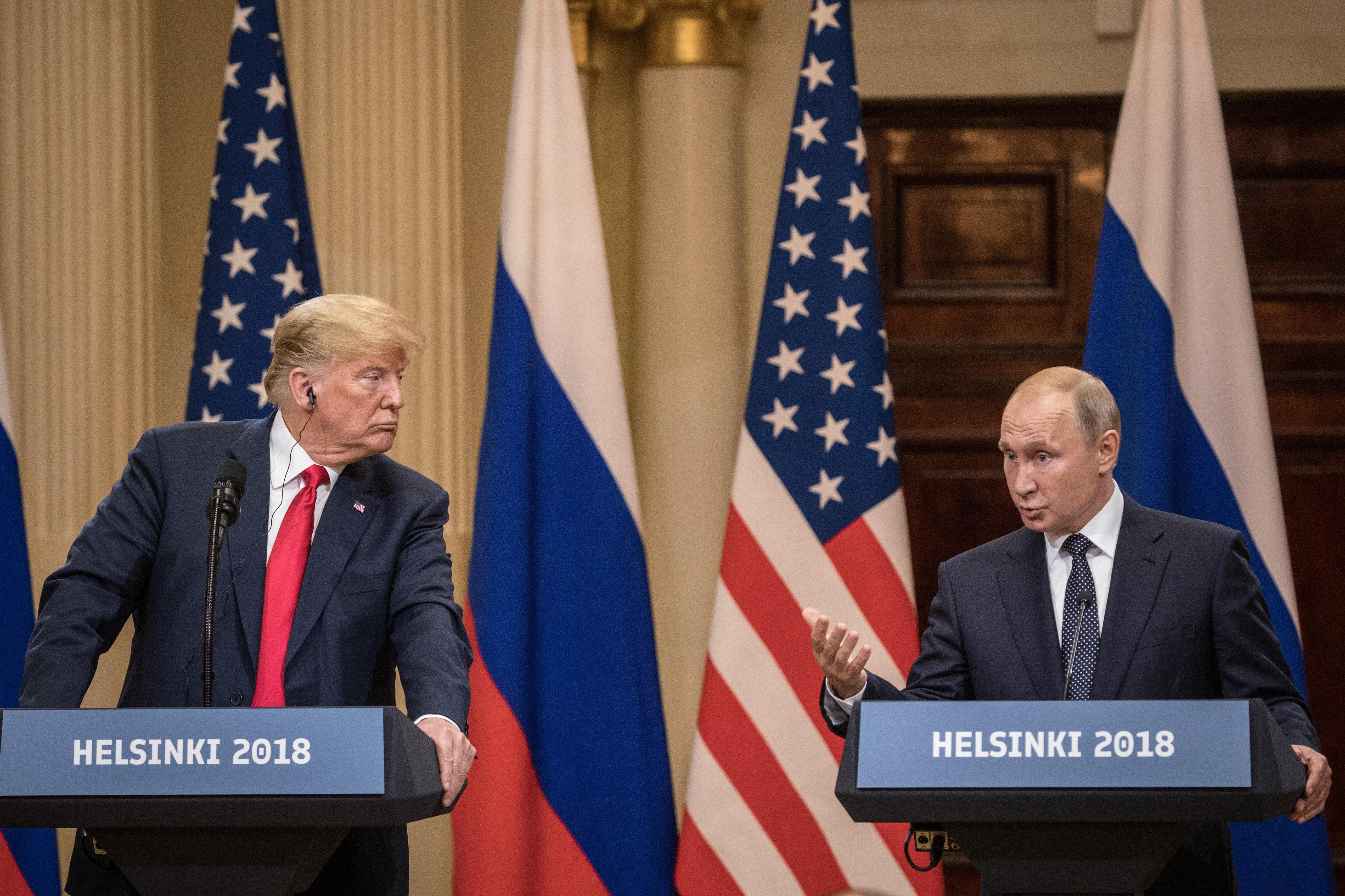U.S. President Donald Trump and Russian President Vladimir Putin stand at podiums during a joint press conference after their summit on July 16 in Helsinki.