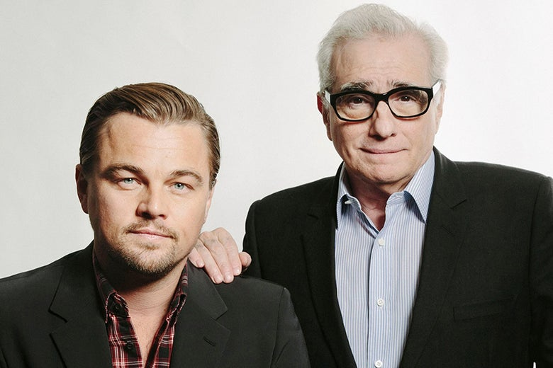 Leonardo DiCaprio and Martin Scorsese pose together with Scorsese's hand on DiCaprio's shoulder.