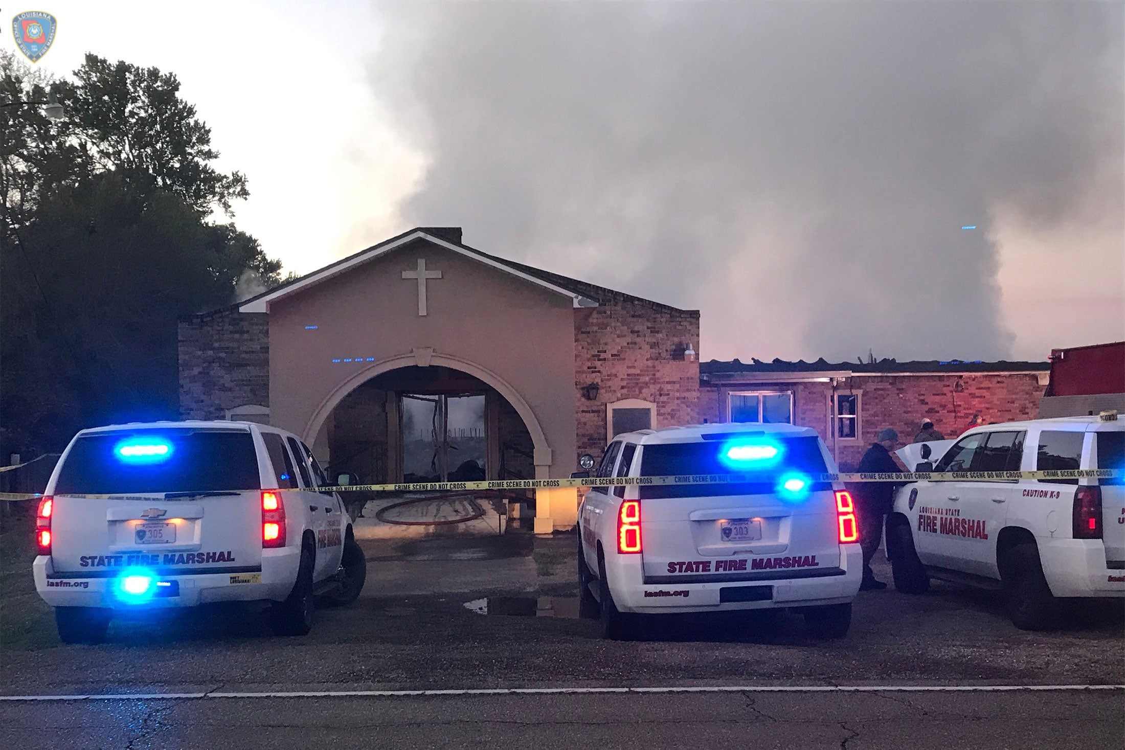 Louisiana State Fire Marshall vehicles are seen outside the Greater Union Baptist Church during a fire, in Opelousas, Louisiana, U.S. April 2, 2019.