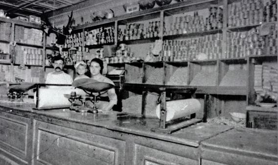 Giorgio Cataudella in his Harlem Macaroni Co. retail shop with his daughters Vera, center, and Antoinette.
