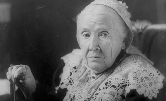 Julia Ward Howe, half-length portrait, seated, facing left.