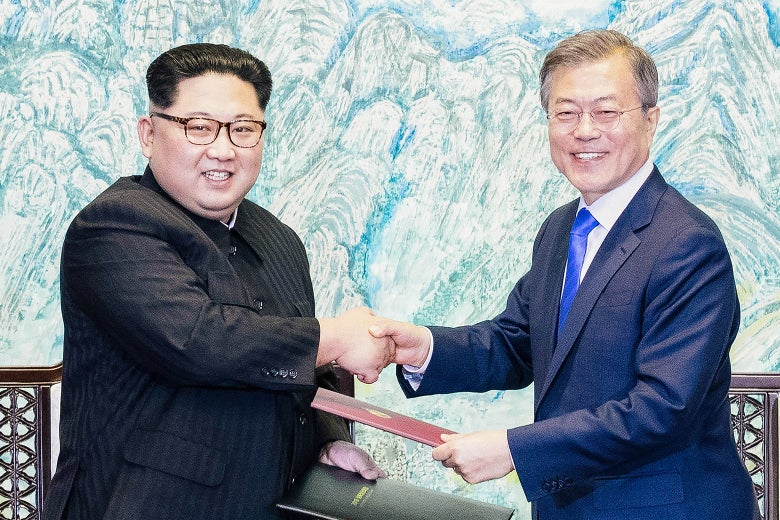 Kim Jong-un and Moon Jae-in shake hands.