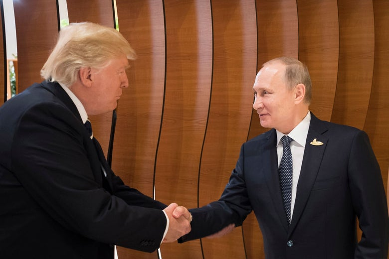 Donald Trump and Vladimir Putin shake hands in front of a wood backdrop.