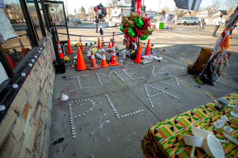 A memorial spells out the name of the shooting victim in George Floyd Square.