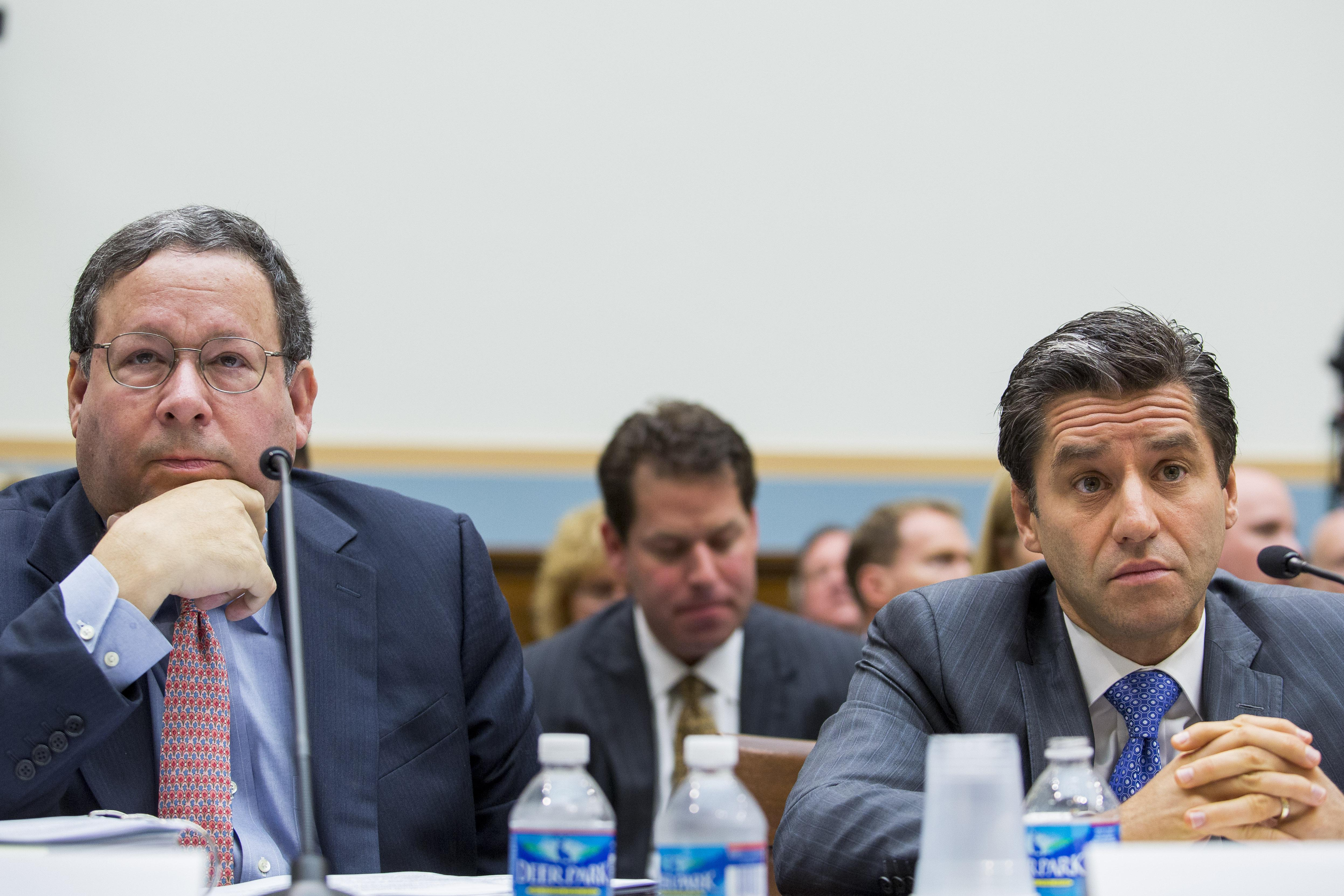 David Cohen, executive vice president of Comcast, and Robert Marcus, CEO of Time Warner Cable, attend a hearing on their proposed merger in May 2014.