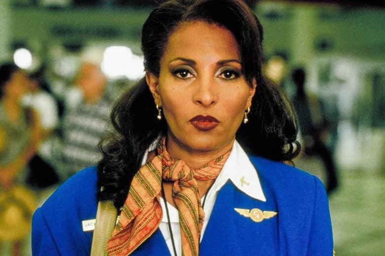 Pam Grier in a flight attendant's blue uniform in Jackie Brown