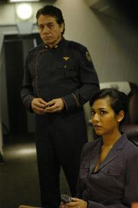 Edward James Olmos (left) and Tory Foster in the Sci Fi Channel's Battlestar Galactica. Click image to enlarged view.