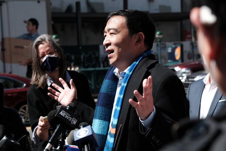 Andrew Yang gestures with both hands while speaking to members of the media in Chinatown on April 5