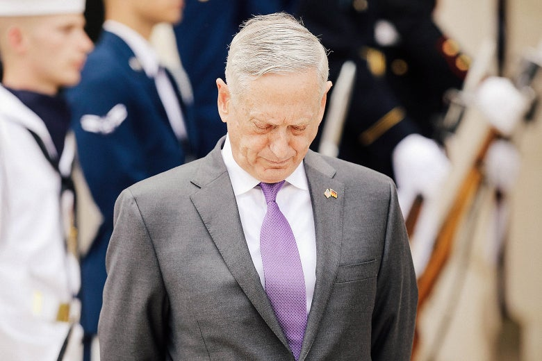 Secretary of Defense James Mattis looks at the ground as he waits for Germany's defense minister to arrive at the Pentagon in Virginia on Wednesday.