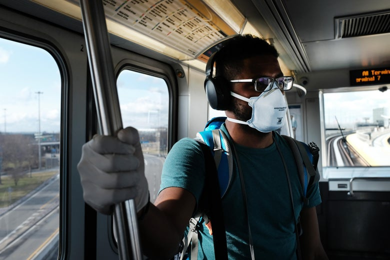 A man wears a medical mask on the AirTrain as concern over the coronavirus grows enroute to John F. Kennedy Airport (JFK) on March 7, 2020 in New York City.