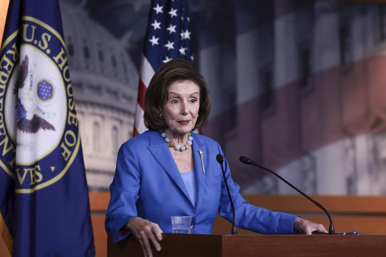 House Speaker Nancy Pelosi stands at a podium and speaks at a news conference at the U.S. Capitol on October 12, 2021 in Washington, DC.