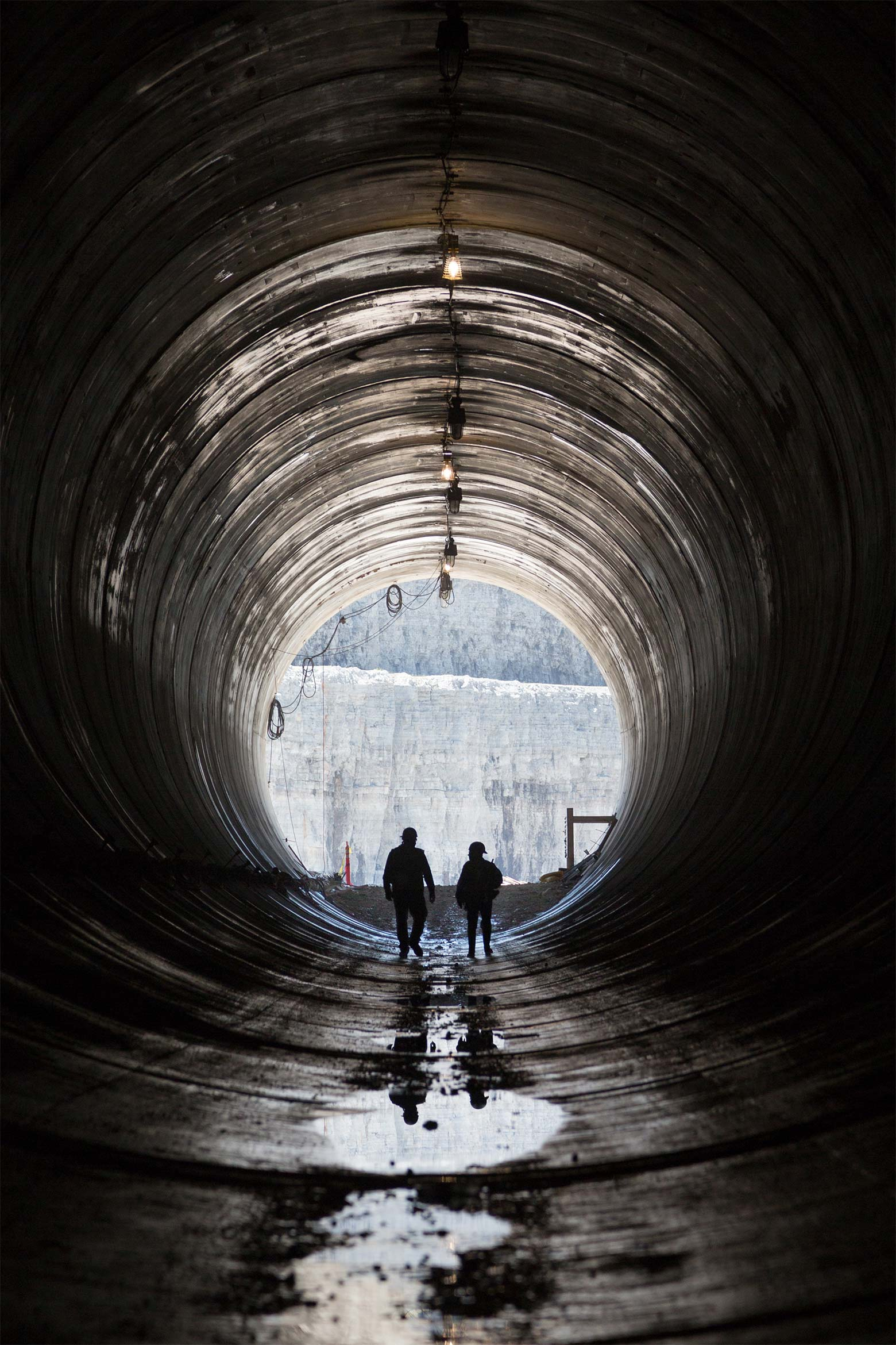 Construction workers exit the Deep Tunnel.