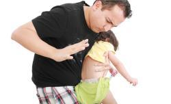 Parent spanking his child.