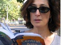 Sharon consults the Lonely Planet guide. Click image to expand.