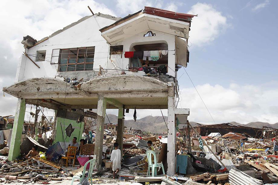 Survivors stay in their damaged house after super Typhoon Haiyan battered Tacloban city, central Philippines November 10, 2013.