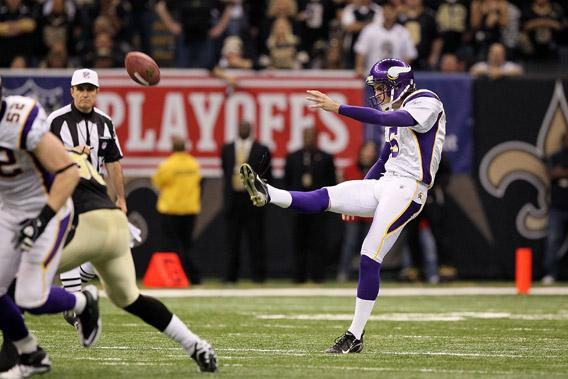 Chris Kluwe of the Minnesota Vikings punts the ball against the New Orleans Saints during the NFC Championship Game at the Louisiana Superdome on January 24, 2010 in New Orleans, Louisiana.