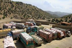 Trucks from Pakistan waiting to be searched at the Ghulam Khan Gate in Khost Province. Click to expand image.