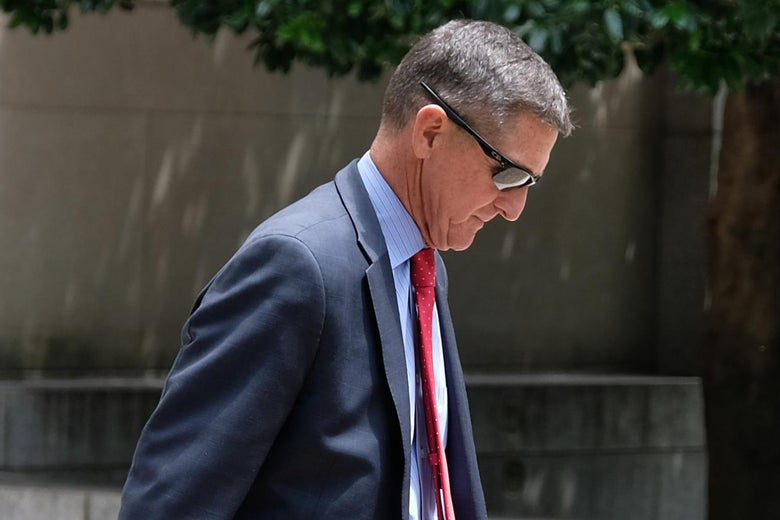Michael Flynn in profile as he walks away outside.