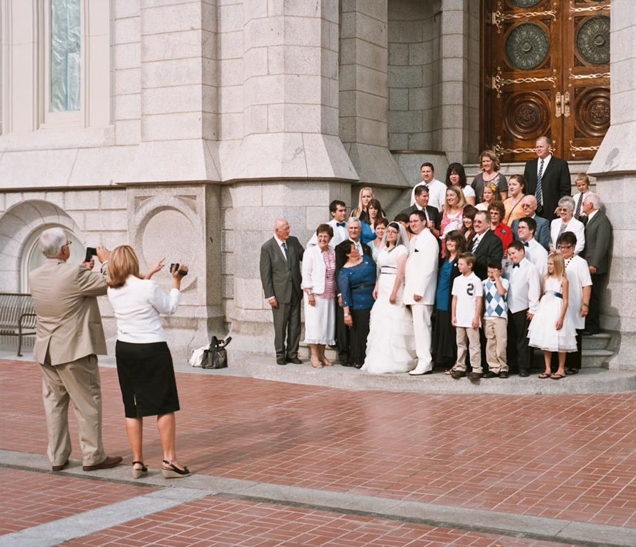 A wedding party poses on the steps of the LDS Temple in Downtown Salt Lake City, Utah. Mormon wedding ceremonies are performed in a semi secret ceremony inside the Temple with only close Mormon family allowed to attend. Afterwards, the couples come out through a doorway at the temple and are greeted by the wedding parties and family and friends.