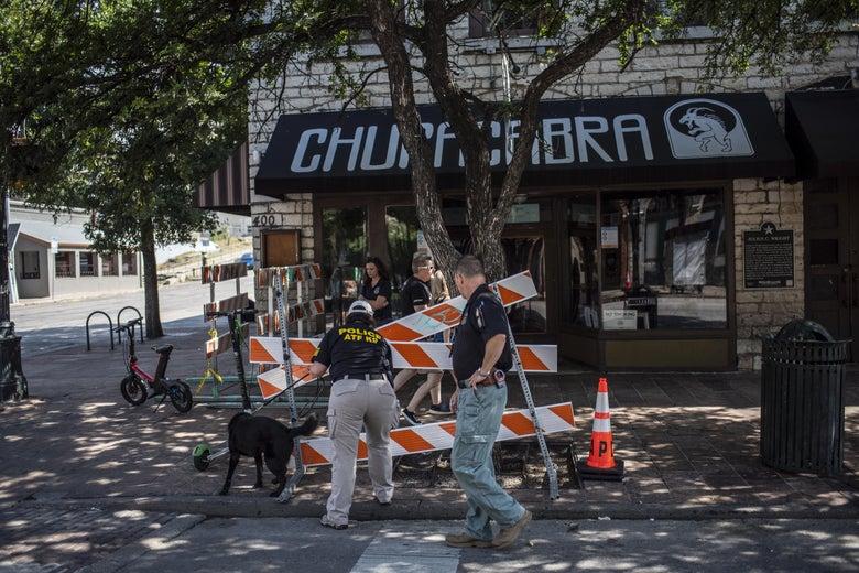 An ATF K9 unit surveys the area near the scene of a shooting on June 12, 2021 in Austin, Texas.