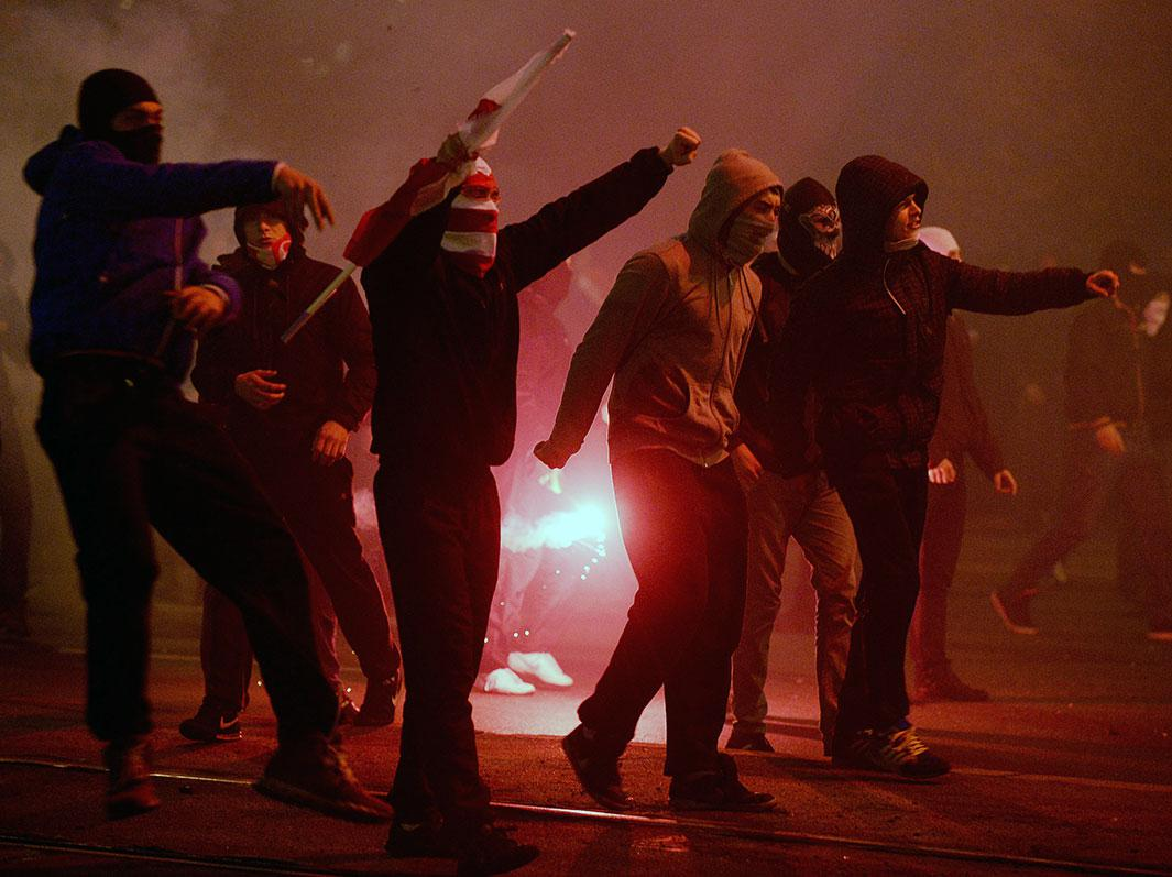 Right-wing nationalist protesters clash with the police during a far-right annual march that coincides with Poland's National Independence Day in Warsaw on Nov. 11, 2014