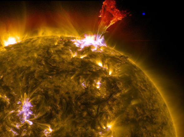 Solar wind versus fusion: How does the Sun lose mass?