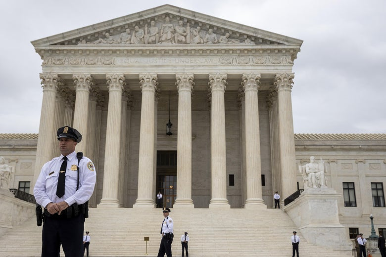 Police stand outside the Supreme Court.