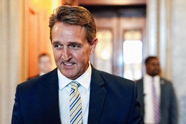 Sen. Jeff Flake leaves the Senate chamber after he delivered a speech on Wednesday at the U.S. Capitol in Washington.