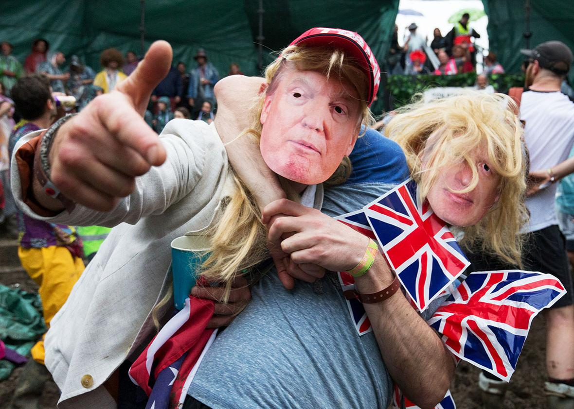 A man dressed as Boris Johnson and Donald Trump prepare to take part in a tomato fight at the Glastonbury Festival 2016 at Worthy Farm, Pilton on June 25, 2016 near Glastonbury, England.