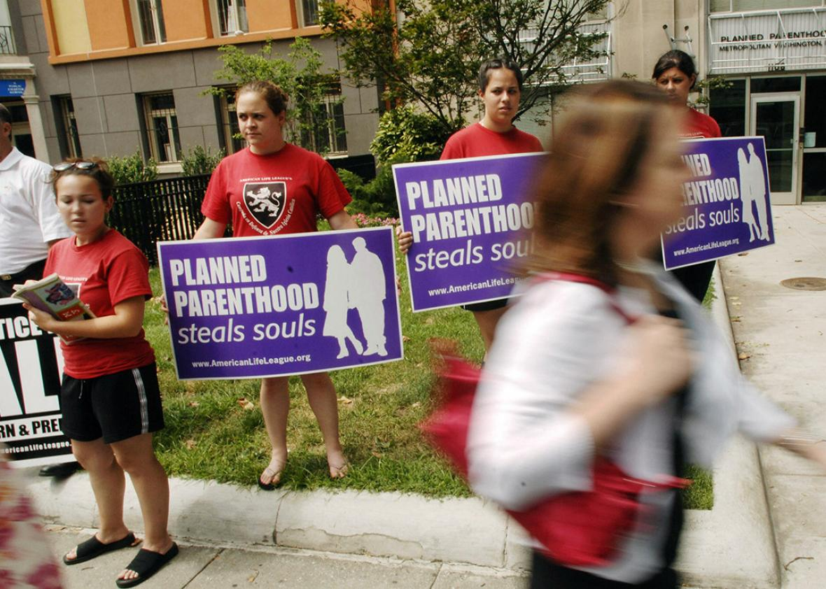 Anti-abortion activists protest outside of a Planned Parenthood