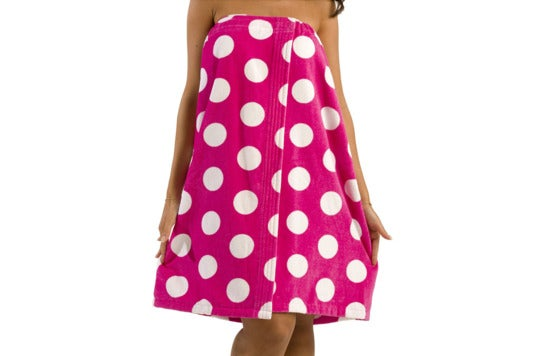 Woman wearing a pink with white polka dots byLora towel.