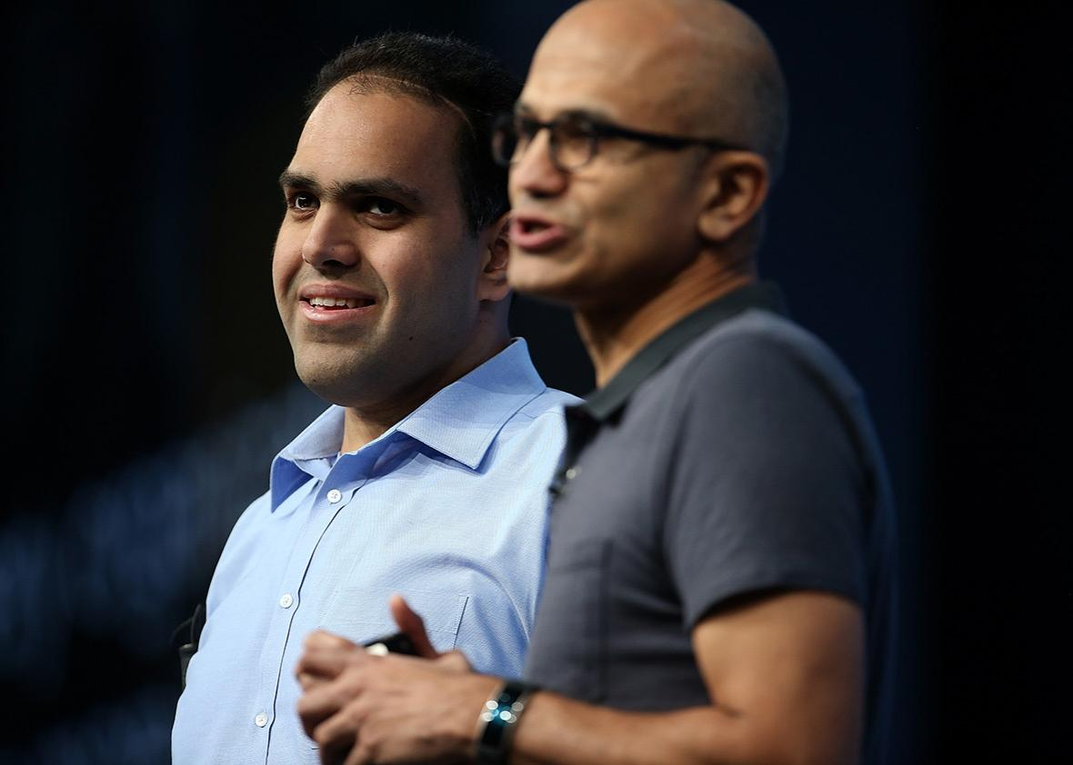 From left, visually impaired Microsoft developer Saqib Shaikh stands next to CEO Satya Nadella during his keynote address at the 2016 Microsoft Build Developer Conference on March 30 in San Francisco.