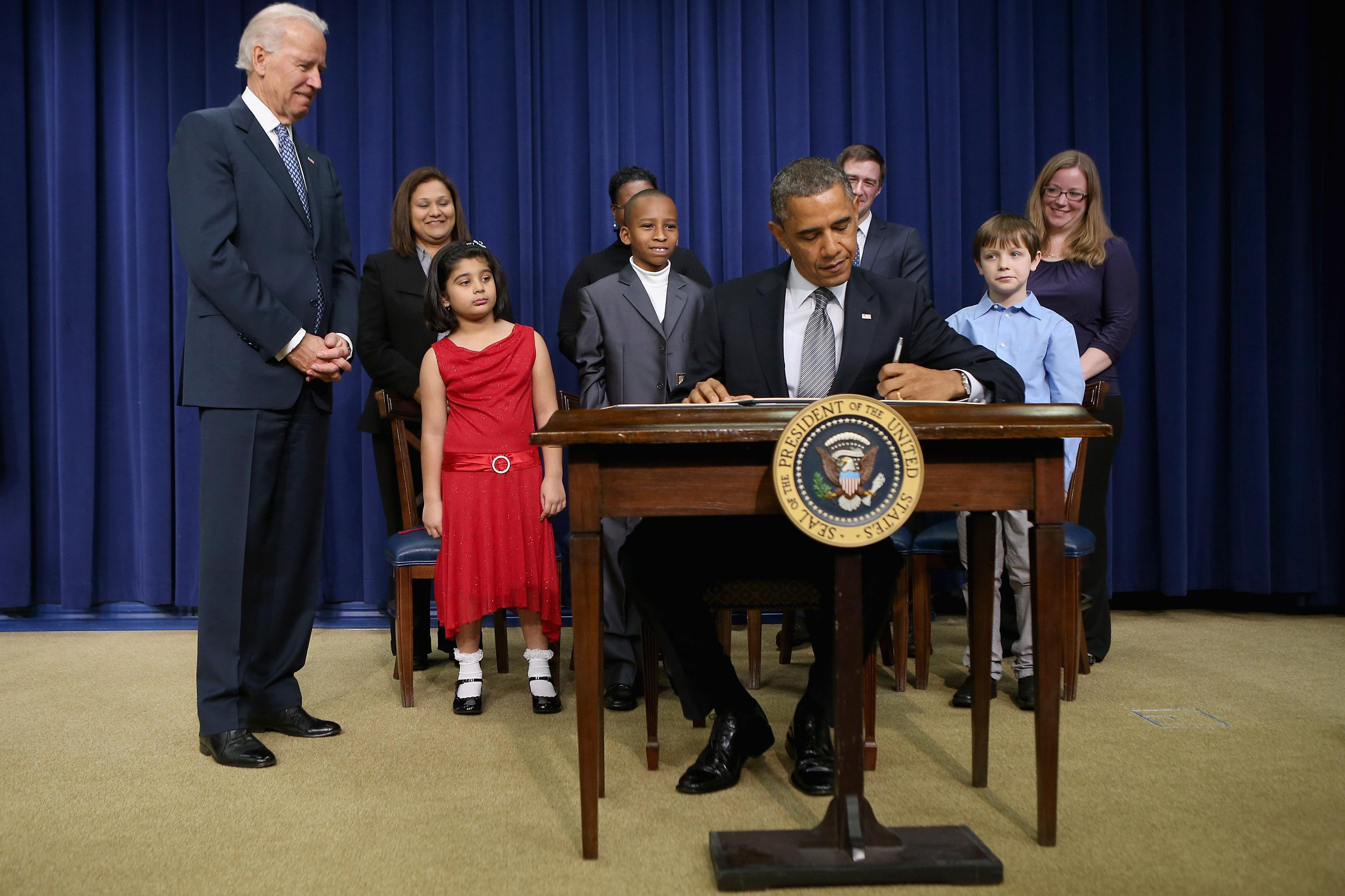 President Obama signs a series of executive orders about the administration's new gun law proposals.