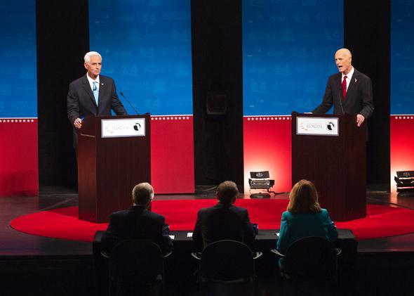 Former Florida governor Charlie Crist and current Gov. Rick Scott finally get the gubernatorial debate going in Davie, Florida, on Oct. 15, 2014