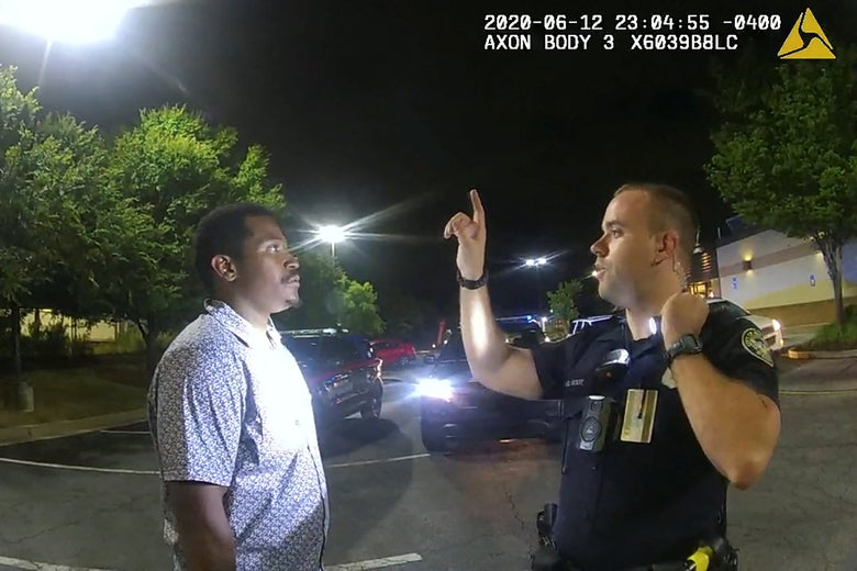 Rolfe raises his index finger in front of Brooks' face during a sobriety test