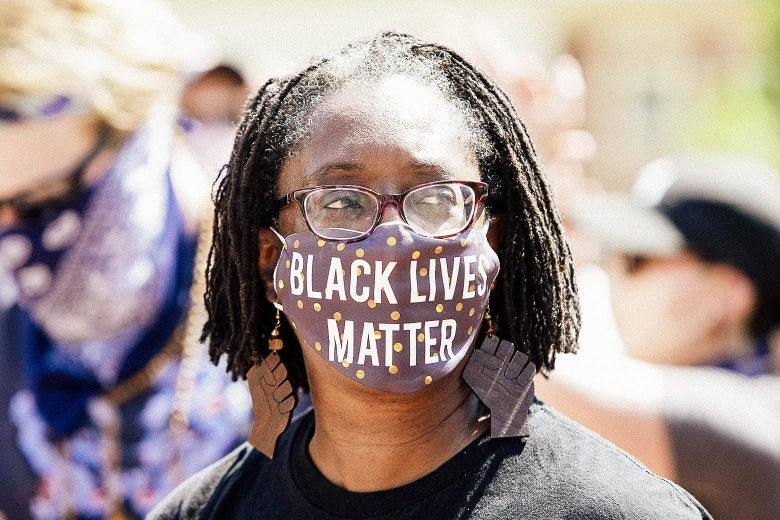 A woman wearing a mask that says Black Lives Matter.