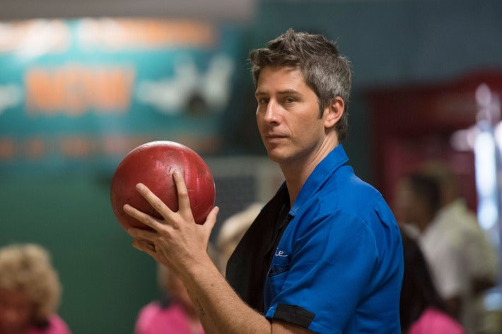 Arie Luyendyk Jr., this year's Bachelor, holds a bowling ball.