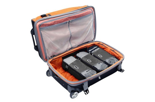 Three slim packing cubes in luggage