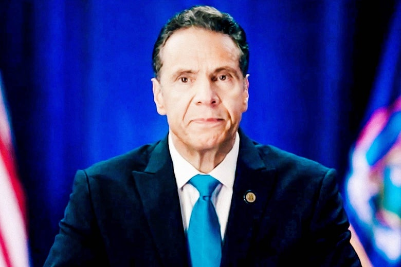 A seated Cuomo stares directly into the camera in a photo taken of a computer screen on which he was appearing.