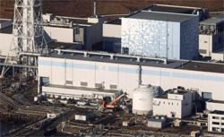 Aerial view of the damaged Fukushima nuclear power plant. Click image to expand.