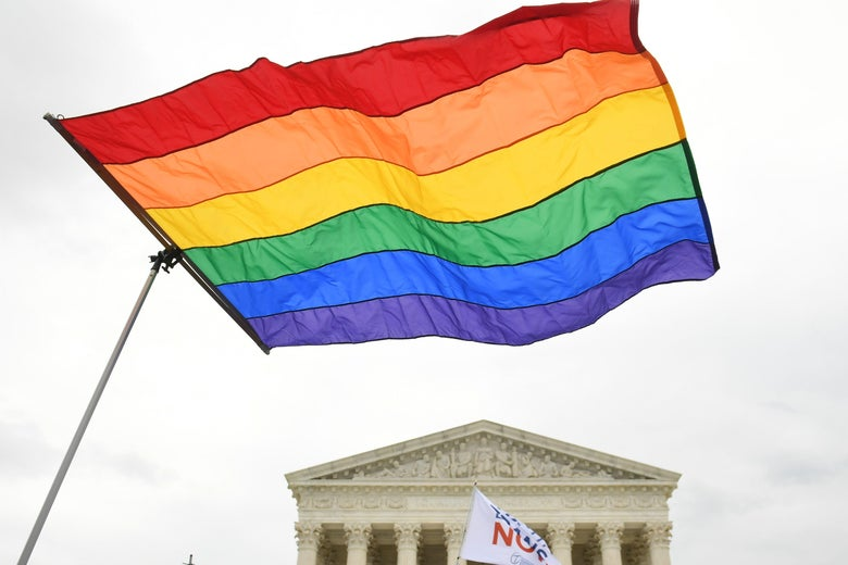 Demonstrators wave a rainbow flag in support of LGBTQ rights outside the Supreme Court.