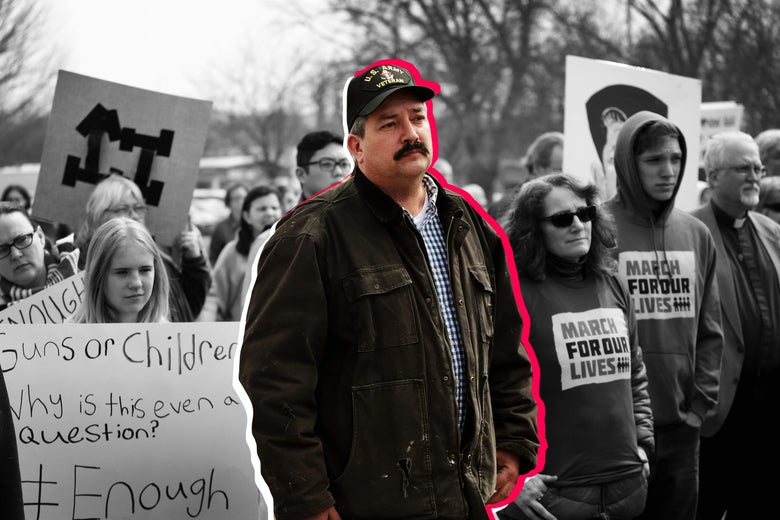 Randy Bryce joins other residents at a rally to show support for students who finished the last leg of a 50-mile march through Wisconsin in the hometown of House Speaker Paul Ryan to call attention to gun violence on March 28 in Janesville, Wisconsin.