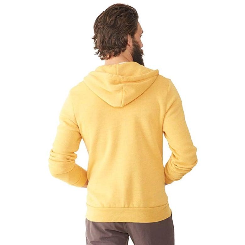 A man wearing a yellow sweatshirt.