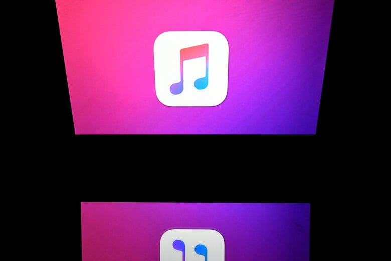 The iTunes logo on a screen onstage.