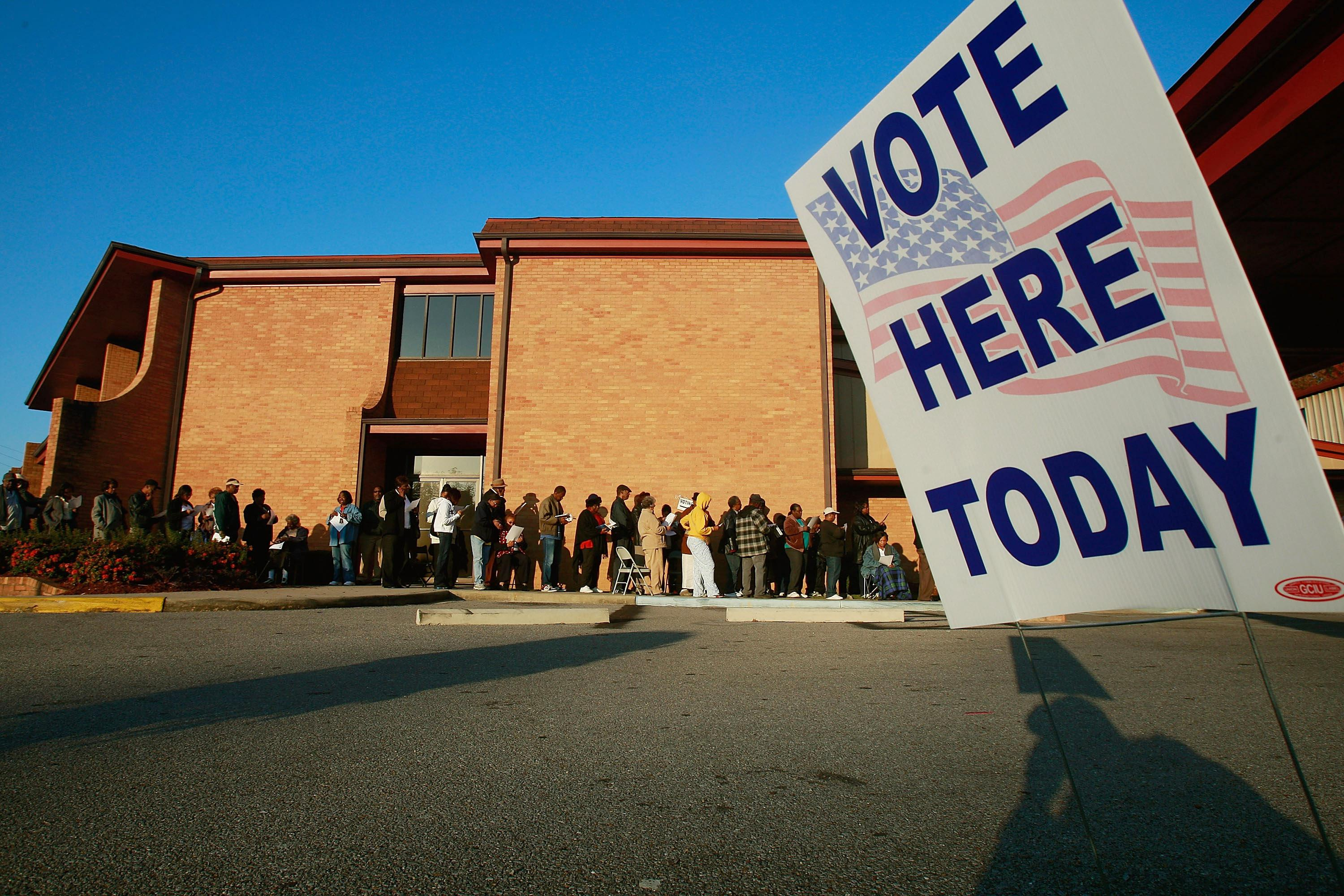 Black voters line up to vote outside Bethel Missionary Baptist Church in the presidential election November 4, 2008 in Birmingham, Alabama.