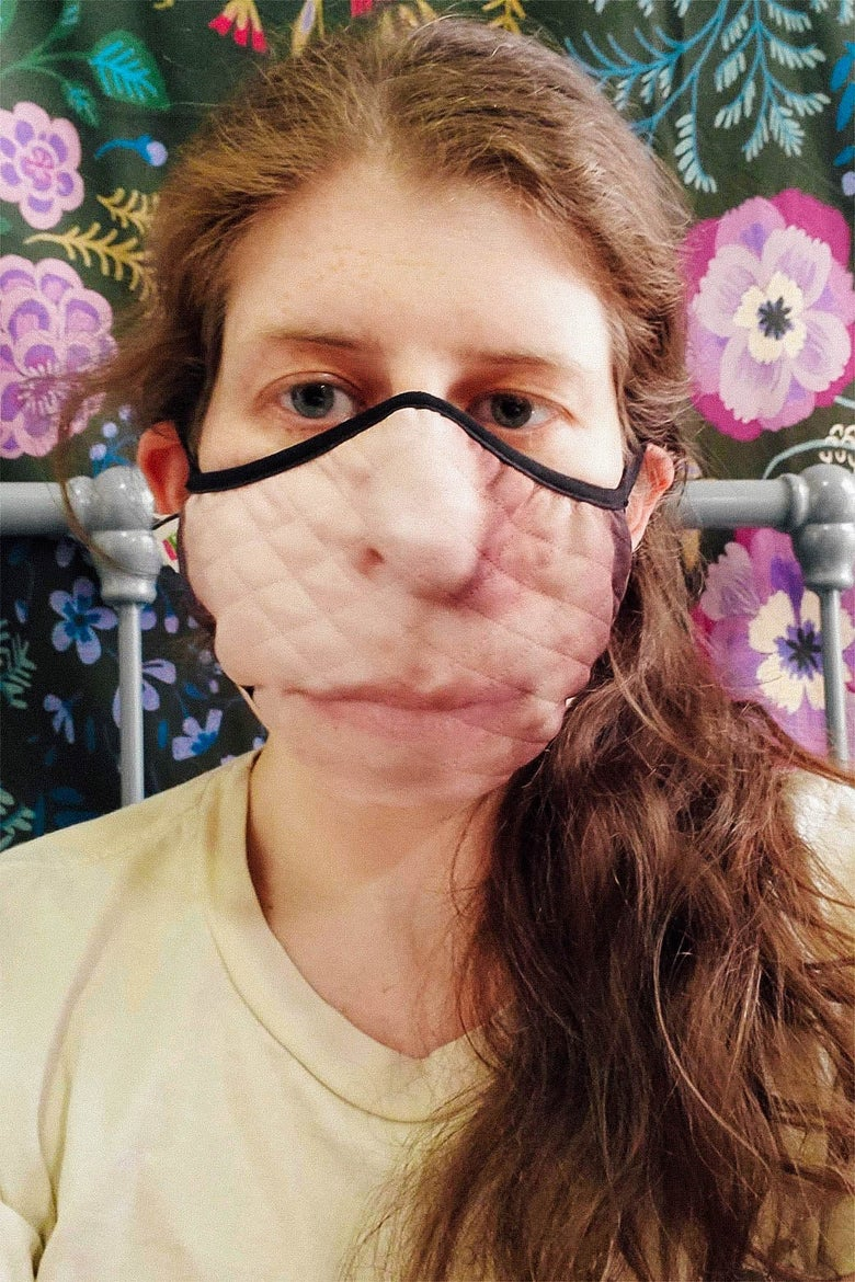 Heather Schwedel in a quilted printed face mask with her face on it.